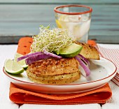 Salmon burger with avocado, bean sprouts and red onions