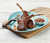 Grilled lamb chops with smoked pepper and orange sauce