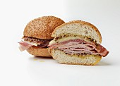 Muffuletta sandwich with sausage and cheese