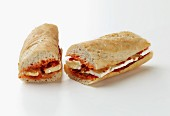 A melted brie and tomato chutney sandwich