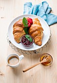 Croissants with raspberry ham, honey and coffee