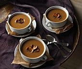 Three cups of chestnut soup with mushrooms