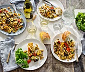 Aubergines with chickpeas and tomatoes served with baguette and white wine