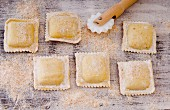 Homemade wholemeal ravioli with a pastry wheel
