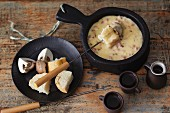 Mushrooms and bacon fondue with bread and mushrooms for dipping