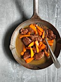 Braised pork cheeks with ginger and carrots