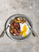 Fried duck eggs with porcini mushrooms and bacon
