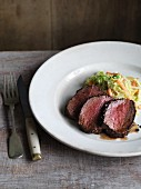 Venison fillet with a pepper crust served with a savoy cabbage and celery medley