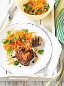 Marinated grilled chicken legs with carrot salad