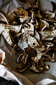 Dried porcini mushrooms on crumpled paper