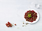 Beetroot carpaccio with red grapes
