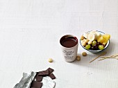 Almond and chocolate fondue with fruit and nuts