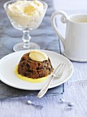 Christmas pudding with brandy butter and vanilla sauce