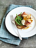 Buckwheat pancakes with apple and scallops wrapped in bacon