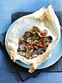 Baked clams with white beans, tomatoes and rosemary