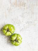 Two green stripped tomatoes