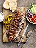 Kebabs with peperoni, unleavened bread and vegetable salad