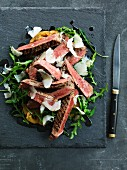 Tagliata Di Manzo with green tomatoes and rocket salad (Italy)