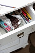 A view of a bar of chocolate in an open drawer