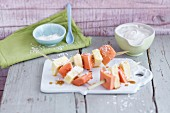Exotic fruit skewers with coconut cream