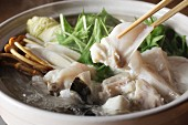 Japanese hot pot with cod, vegetables and mushrooms