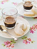 Almond crescent biscuits with black coffee