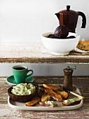 Avocado dip, crostini and coffee
