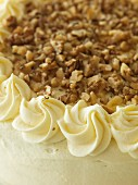 Banana and caramel cake with chopped nuts (detail)