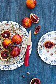 Blood oranges on decorative plates