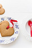 Heart-shaped gingerbread biscuits with spotted ribbons