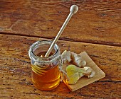 A jar of honey and root ginger