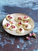 White chocolate rounds decorated with petals