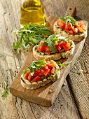 Bruschetta al pesto (grilled bread topped with pesto and tomatoes, Italy)