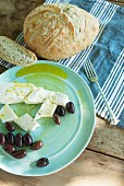 Sheep's cheese and black olives with olive oil and country bread