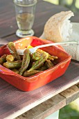 Greek style pickled okra with white bread and wine
