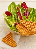 Potato waffles with a mixed leaf salad