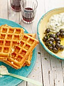 Feta cheese waffles served with olives and tzatziki