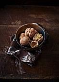 Fresh walnuts in a ceramic dish