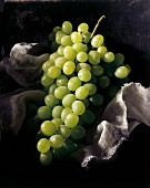Green grapes on a piece of muslin