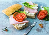 A cream cheese, ham and tomato sandwich