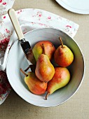 Clapp's Favourite pears in a bowl with a knife