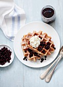 Waffles with cream and berry compote