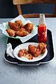 Chicken wings with chilli sauce on a tray