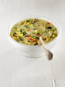 Corn Chowder with potatoes, red and green peppers, celery, parsley and onions