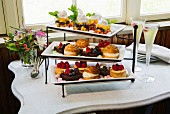 Various tartlets and profiteroles on a cake stand