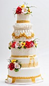 A baroque wedding cake decorated with sugar flowers