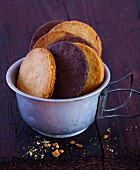 Light and dark butter biscuits in a tin cup