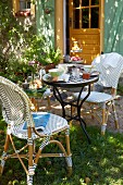 French breakfast with bistro furniture in a sunny garden