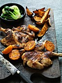 Spiced poussins with grilled clementines (Asia)