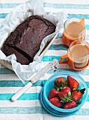 Chocolate cake from Spain with strawberries and tea